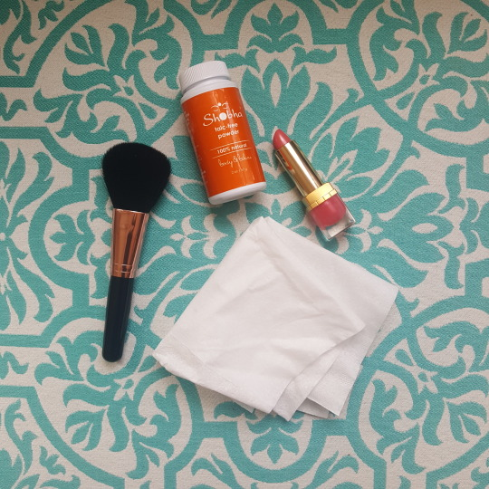 tissues and talc free powder with lipstick